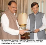 Mr. Abdur Rauf Chaudhry, Federal Tax Ombudsman, presenting annual report 2013 of FTO to President Mamnoon Hussain at the Aiwan-e-Sadr on July 25, 2014.