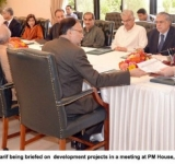 Prime Minister, Muhammad Nawaz Sharif being briefed on  development projects in a meeting at PM House, Islamabad on July 11, 2014
