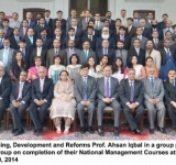 Federal Minister for Planning, Development and Reforms Prof. Ahsan Iqbal in a group photo with officers of differenct occupational group on completion of their National Management Courses at national Management College Lahore on July 10, 2014