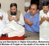 Minister of State for Education, Training and Standards in Higher Education, Muhammad Baligh Ur Rehman offering fateha with Malik Muhammad Iqbal, Provincial Minister of Punjab on the death of his sister in Bhawalpur on July 12, 2014