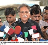 Federal Minister for Information & Broadcasting and National Heritage, Senator Pervaiz Rashid talking to media at Lahore on July 12, 2014