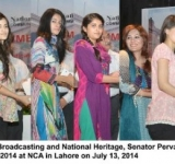 Federal Minister for Information, Broadcasting and National Heritage, Senator Pervaiz Rashid giving away certificates to the students of Summer Camp-2014 at NCA in Lahore on July 13, 2014