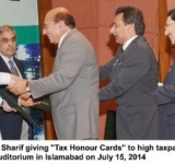 """Prime Minister Muhammad Nawaz Sharif giving """"Tax Honour Cards"""" to high taxpayers in last financial year in a ceremony held at PM office Auditorium in Islamabad on July 15, 2014"""