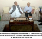 President Mamnoon Hussain enquiring about the health of known literary figure of the country Mushtaq Ahmed Yousufi at his residence in the metropolis here on Tuesday at Karachi on 22 July 2014