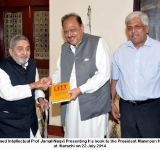 Renowned Intellectual Prof Jamal Naqvi Presenting his book to the President Mamnoon Hussain at  Karachi on 22 July 2014