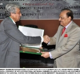 PRESIDENT MAMNOON HUSSAIN BEING PRESENTED A SHIELD BY CHAIRMAN PAEC DR. ANSAR PARVEZ DURING  THE INAUGURAL CEREMONY OF 39TH INTERNATIONAL NATHIAGALI SUMMER COLLEGE ON PHYSICS AND CONTEMPORARY NEEDS AT THE NATIONAL CENTRE FOR PHYSICS QUAID-E-AZAM UNIVERSITY, ISLAMABAD ON AUGUST 04, 2014.