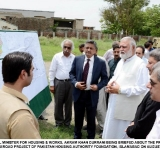 FEDERAL MINISTER FOR HOUSING & WORKS, AKRAM KHAN DURRANI BEING BRIEFED ABOUT THE PROGRESS OF KURRI ROAD PROJECT OF PAKISTAN HOUSING AUTHORITY FOUNDATION, ISLAMABAD ON AUGUST 06, 2014.