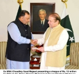 Ex-MNA Chaudhry Saud Majeed presenting a cheque of Rs. 10 million for IDPs to the Prime Minister Muhammad Nawaz Sharif at PM House Islamabad on 7th July, 2014.
