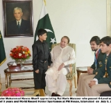 Islamabad, July 9, 2014 :Prime Minister Muhammad Nawaz Sharif appreciating Rai Haris Manzoor who passed O-Level exam at the age of 9 years and World Record Holder Sportsmen at PM House, Islamabad  on  July 9, 2014